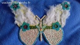 Joli papillon support en bois a suspendre décoré