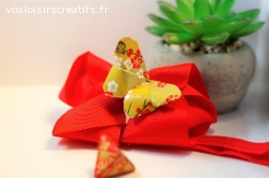 Papillon origami or et rouge sur un headband Noeud Rouge