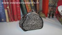 Porte-monnaie imprimé noir/beige coton bordé de simili cuir